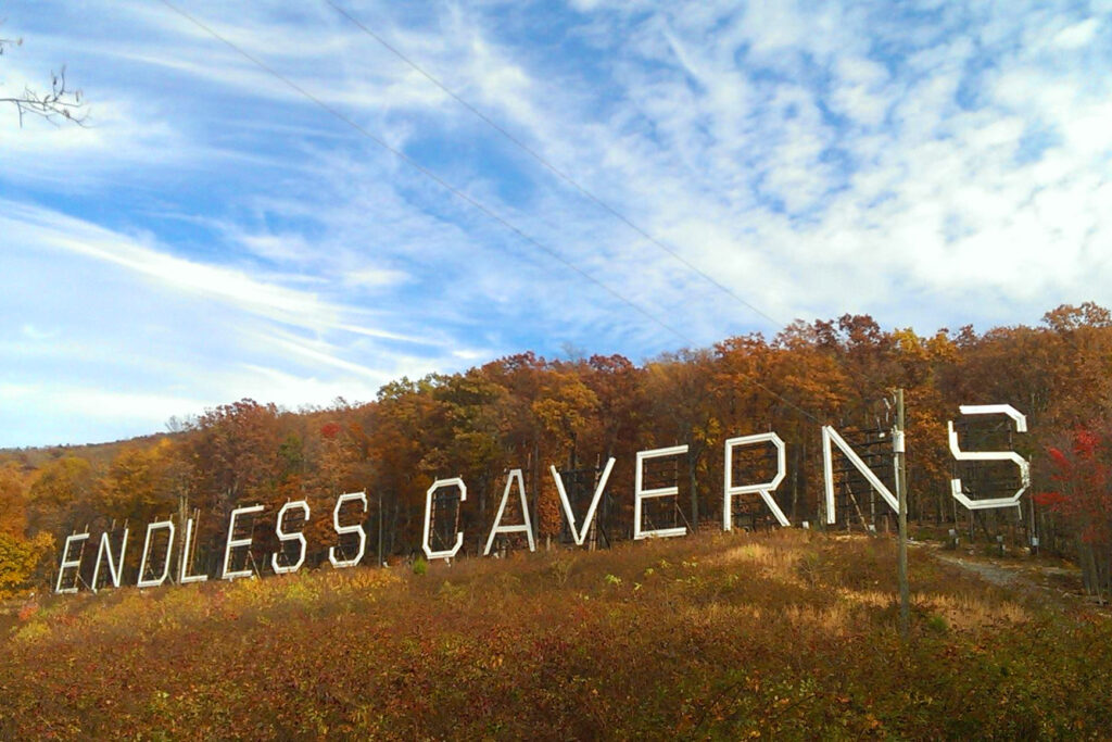Mountain side displaying the words Endless Caverns